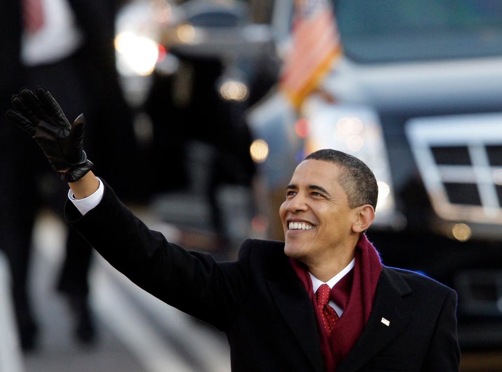 . President Barack Obama waves as he walks down Pennsylvania Avenue on his way to the White House in Washington Tuesday, Jan. 20, 2009. (AP Photo/Alex Brandon)