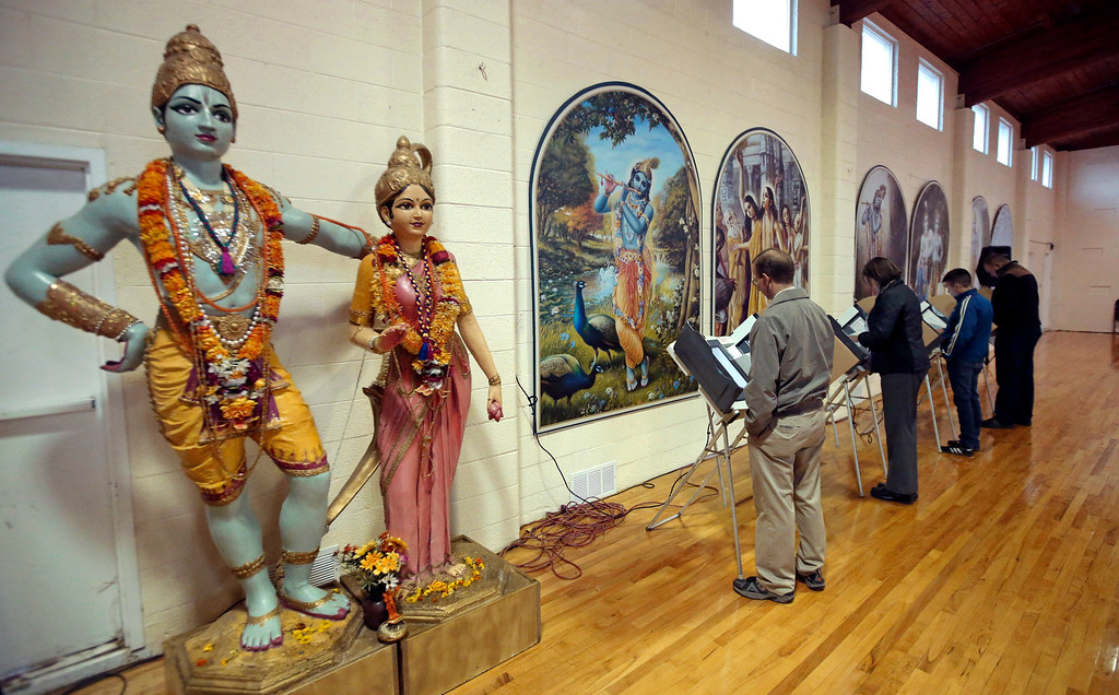. People vote at the polling place in Krishna Temple during election day Tuesday, Nov. 4, 2014, in Salt Lake City. Utah\'s most watched race this year is the contest to replace longtime Democratic Rep. Jim Matheson in Utah\'s 4th Congressional District.   (AP Photo/Rick Bowmer)