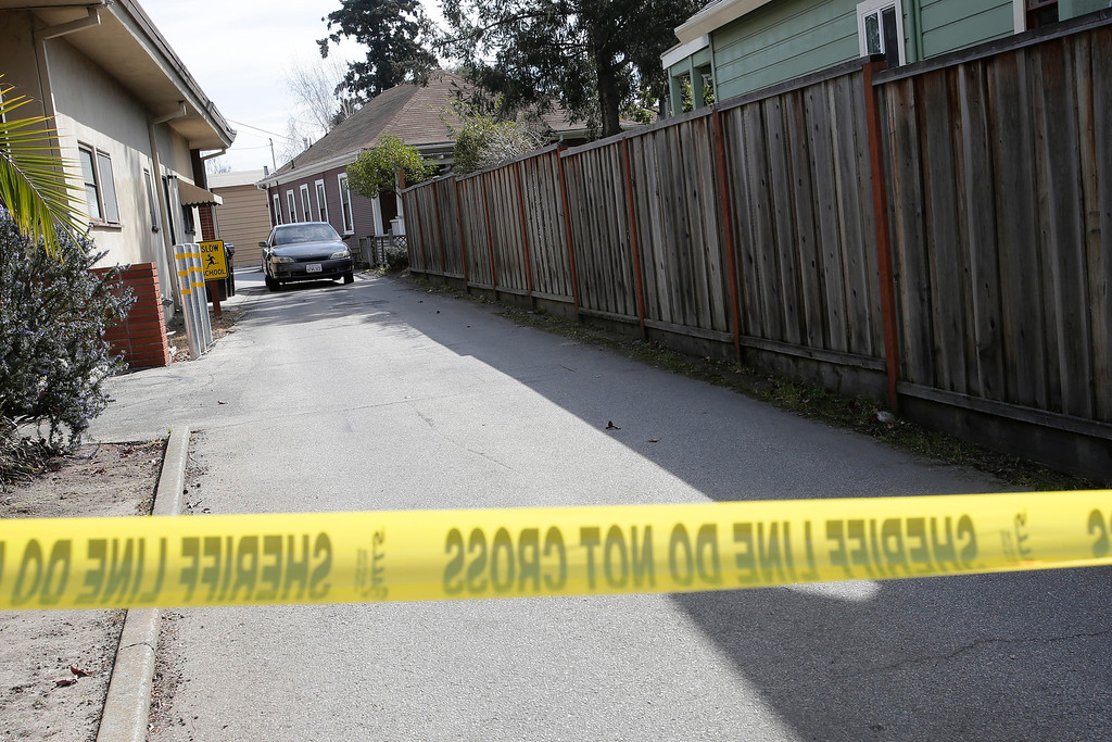 """. This is the crime scene on Branciforte Ave. in Santa Cruz, Calif. on Wednesday, Feb. 27, 2013 where Santa Cruz police officers, detective Sgt. Loran \""""Butch\"""" Baker and detective Elizabeth Butler were shot and killed yesterday. The pair were gunned down while investigating a possible domestic violence or sexual assault when a suspect fired at them. The gunman, Jeremy Peter Goulet, was later gunned down when he exchanged gunfire with police during a manhunt. The back home is believed to that of the suspect. (Gary Reyes/ Staff)"""