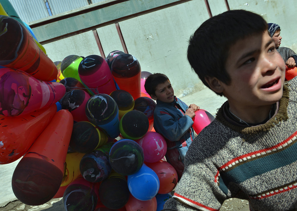 . Afghan boys sell balloons in a street near the Sakhi shrine, the centre of the Afghanistan new year celebrations in Kabul during Nowruz festivities on March 21, 2013. Nowruz, one of the biggest festivals of the war-scarred nation, marks the first day of spring and the beginning of the year in the Persian calendar. Nowruz is calculated according to a solar calendar, this coming year marking 1392.  MASSOUD HOSSAINI/AFP/Getty Images