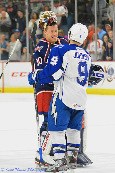 Syracuse Crunch Tyler Johnson (9) shakes Springfield Falcons goalie Curtis McElhinney's (30) hand after defeating the Falcons in the  American Hockey League (AHL) Calder Cup Playoff series at the Onondaga County War Memorial on Friday, May 17, 2013.