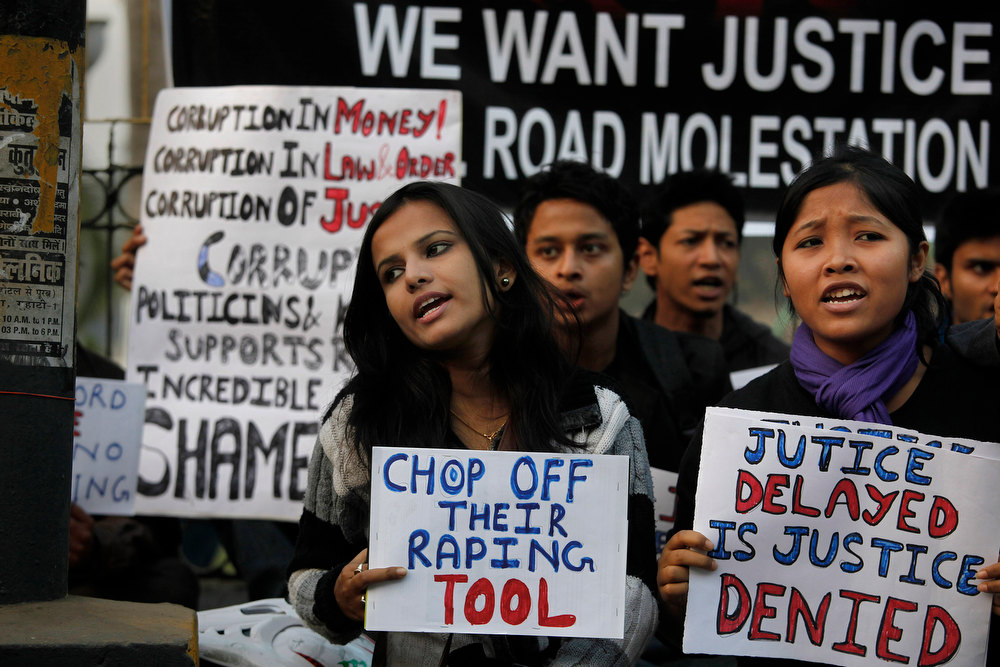 . Students participate in a protest against a leader of the ruling Congress party, who was arrested on accusations he raped a woman in a village in the early hours of the morning, in Gauhati, India, Thursday, Jan. 3, 2013. Footage on Indian television showed the extraordinary scene of local women surrounding Bikram Singh Brahma, ripping off his shirt and repeatedly slapping him across the face. A Dec. 16 gang rape on a woman, who later died of her injuries, has caused outrage across India, sparking protests and demands for tough new rape laws, better police protection for women and a sustained campaign to change society\'s views about women. (AP Photo/Anupam Nath)