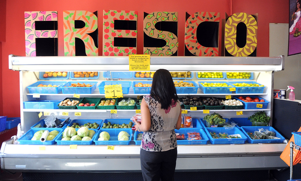 . Locals shop for fresh produce after a press conference announcing new data on the availability and marketing of tobacco, alcohol and food products in stores at Euclid Market in Los Angeles on Wednesday, March 5, 2014.  (Keith Birmingham Pasadena Star-News)