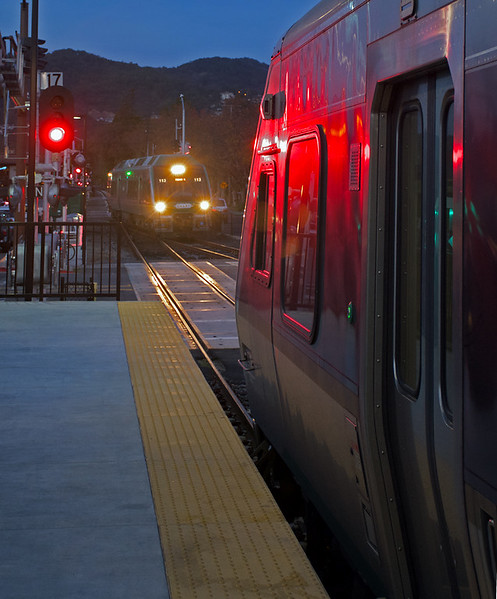 December 1, 1017.  In the early evening a northbound train waits at the San Rafael station for a southbound train to clear the main.