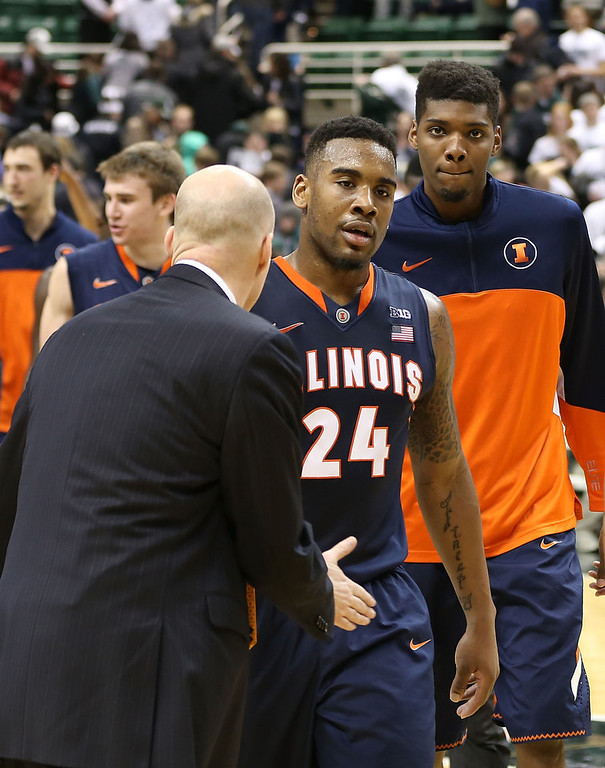 . University of Illinois head basketball coach John Groce congratulates Rayvonte Rice #24 after the win over the Michigan State Spartans at Breslin Center on March 1, 2014 in East Lansing, Michigan. Illinois defeated Michigan State 53-46.  (Photo by Leon Halip/Getty Images)