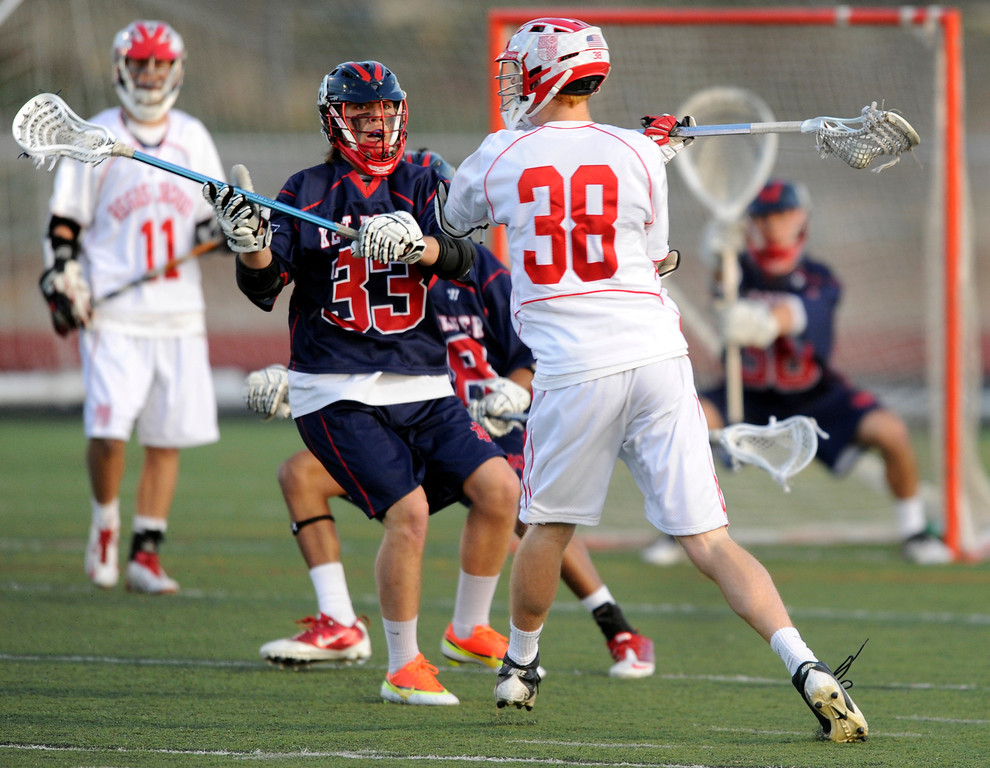 . AURORA, CO. - APRIL 24:  Raiders sophomore Chase Konkel (38) worked the ball around the perimeter in the first half. The Regis Jesuit High School boy\'s lacrosse team defeated Kent Denver 10-8 Wednesday night, April 24, 2013. Photo By Karl Gehring/The Denver Post