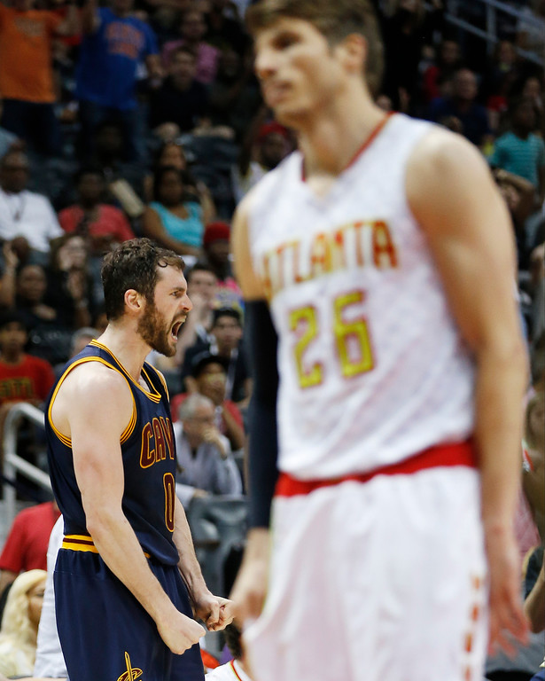 . Cleveland Cavaliers forward Kevin Love, left, celebrates his three-point shot against Atlanta Hawks in the second half of Game 4 of the second-round NBA basketball playoff series, Sunday, May 8, 2016, in Atlanta. (AP Photo/John Bazemore)