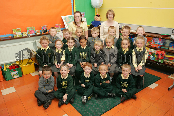 Pictured with Teacher Mrs Louise Auden anfd Classroom Assistant Miss Ashlynn Fearon are the new Primary 1 pupils from St Patrick's P.S. Newry. 07W37N25