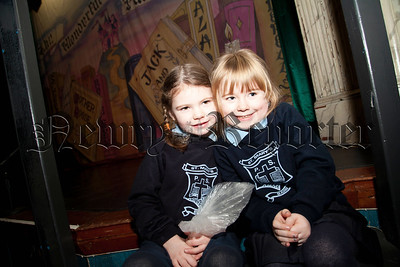 Primary 1 pupils Claire McGeown and Naimh Byrne getting reeady for the panto at the Town Hall. R1404006