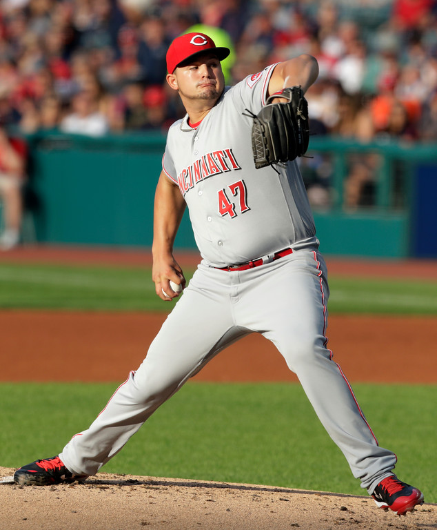 . Cincinnati Reds starting pitcher Sal Romano delivers in the first inning of the team\'s baseball game against the Cleveland Indians, Tuesday, July 10, 2018, in Cleveland. (AP Photo/Tony Dejak)