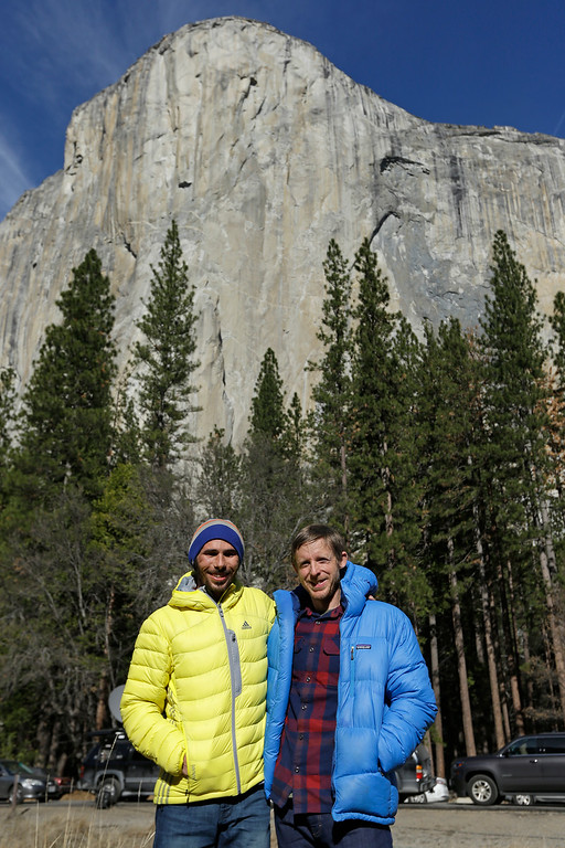 . Climbers Kevin Jorgeson, left, and Tommy Caldwell are seen at the base of El Capitan after a news conference Thursday, Jan. 15, 2015, in Yosemite National Park, Calif. The two climbers became the first in the world to use only their hands and feet to scale El Capitan, a sheer granite face in California\'s Yosemite National Park. (AP Photo/Ben Margot)