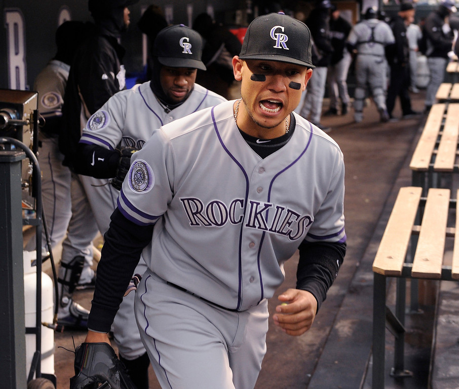 . Carlos Gonzalez let out a yell as the Rockies took the field for the second game. The Colorado Rockies hosted the New York Mets in the second game of a doubleheader on April 16, 2013.   Photo By Karl Gehring/The Denver Post)