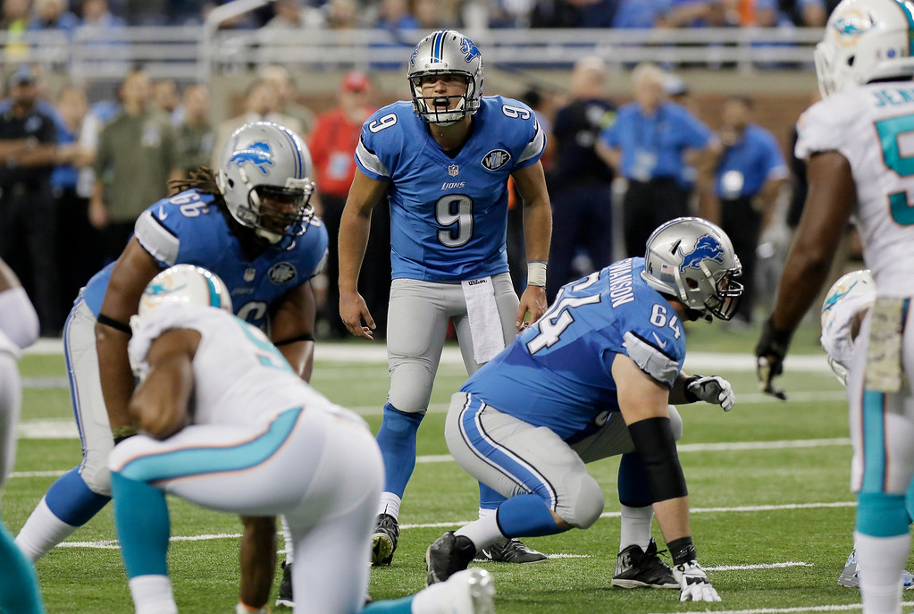 . Detroit Lions quarterback Matthew Stafford (9) calls out a play during the first half of an NFL football game against the Miami Dolphins in Detroit, Sunday, Nov. 9, 2014. (AP Photo/Duane Burleson)