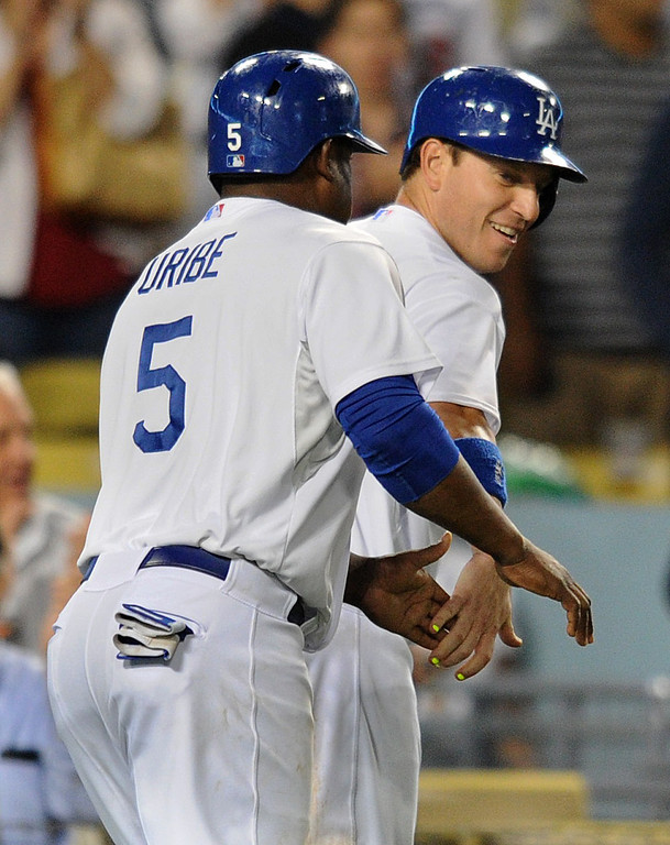 . Juan Uribe and A.J. Ellis celebrate being driven in by a Nick Punto double in the 5th inning. The Dodgers played the New York Mets in a game at Dodger Stadium in Los Angeles, CA. 8/13/2013(John McCoy/LA Daily News)