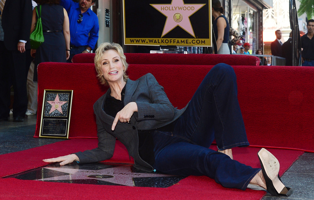 . Actress Jane Lynch poses on her \'Star\' during a cermony honoring her with the 2,505 Star on the Hollywood Walk of Fame in the category of television on September 4, 2013 in Hollywood, California.        (FREDERIC J. BROWN/AFP/Getty Images)