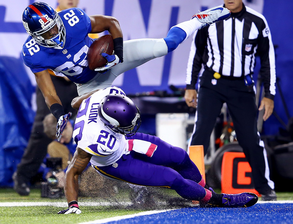 . Wide receiver Rueben Randle #82 of the New York Giants catches a touchdown in the second quarter as cornerback Chris Cook #20 of the Minnesota Vikings defends during a game at MetLife Stadium on October 21, 2013 in East Rutherford, New Jersey.  (Photo by Al Bello/Getty Images)
