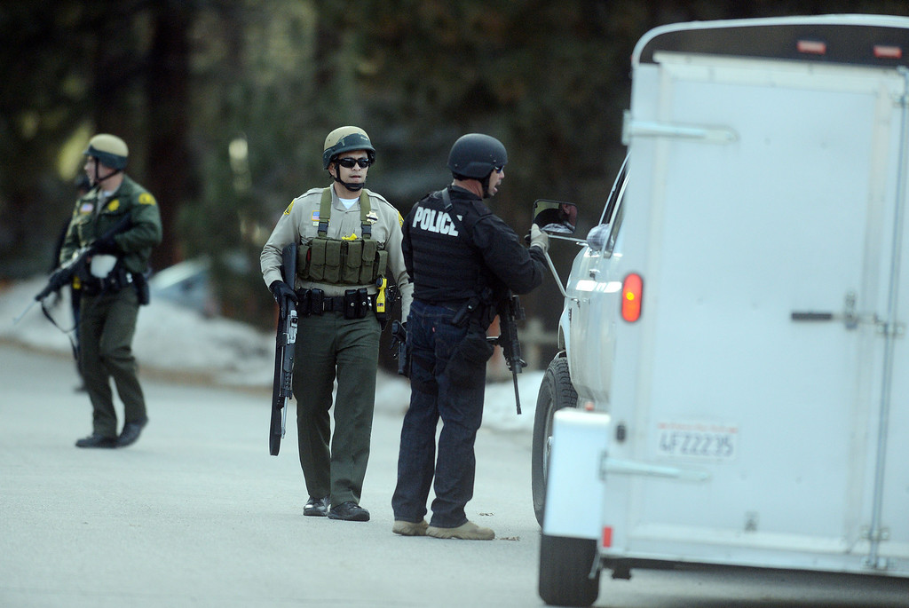 . Law enforcement search door-to-door for ex-LAPD officer Christopher Jordan Dorner near Bear Mountain in Big Bear Thursday February 7, 2013.(Staff photo by Will Lester/Inland Valley Daily Bulletin)