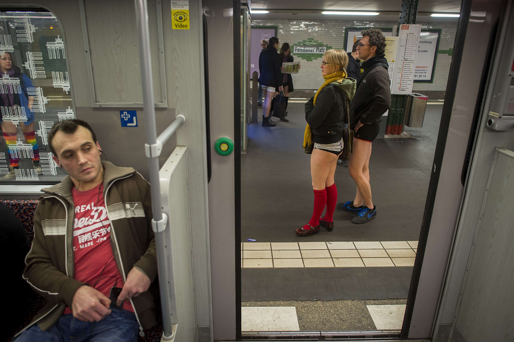 """. The doors close as people taking part in the \""""No Pants Subway Ride\"""" are seen on the platform at the Potsdamer Platz station on the U2 Subway line in Berlin on January 12, 2014. \""""No Pants Subway Ride\"""",  is an annual event in which transit passengers ride trains without wearing pants in January. The event is observed in dozens of cities worldwide. In the UK, where the word pants refers to underwear, the event has been translated as \""""No Trousers\"""".   ODD ANDERSEN/AFP/Getty Images"""