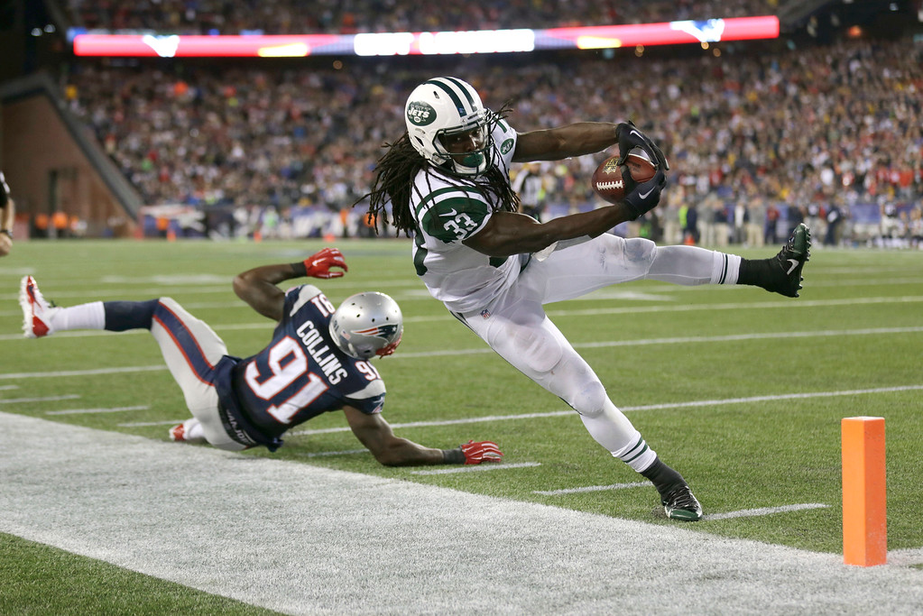 . New York Jets running back Chris Ivory (33) goes out of bounds just short of the goal line next to New England Patriots outside linebacker Jamie Collins (91) in the second half of an NFL football game Thursday, Oct. 16, 2014, in Foxborough, Mass. (AP Photo/Charles Krupa)