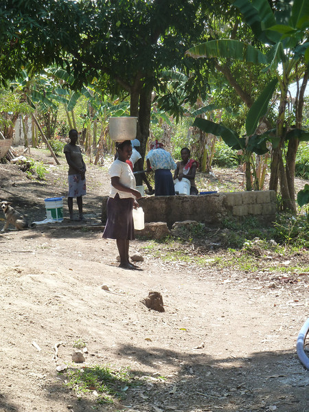 carrying water from the only community well