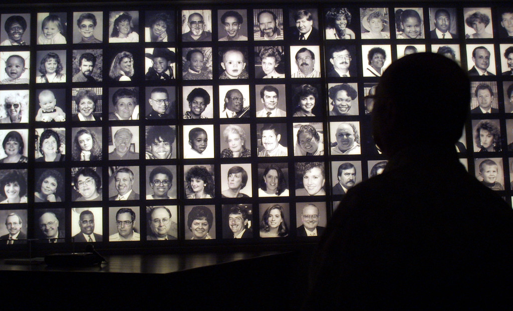 . A visitor looks at the faces of some of the victims of the Oklahoma City bombing at the Oklahoma National Memorial museum in Oklahoma City June 12, 2001, one day after the execution of Timothy McVeigh. (Photo by Joe Raedle/Getty Images)