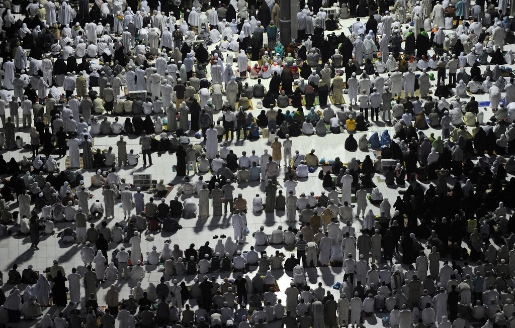 . A general view shows pilgrims performing evening prayers in Mecca\'s Grand Mosque on October 8, 2013. More than two million Muslims have arrived in the holy city for the annual hajj pilgrimage, one of the world\'s largest human assembly, which begins on October 13 amid concerns over the deadly MERS coronavirus. (FAYEZ NURELDINE/AFP/Getty Images)