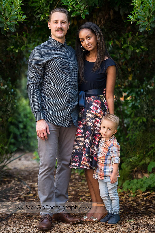 full body portrait of family of 3 in Shinn Historical Park and Arboretum in Fremont