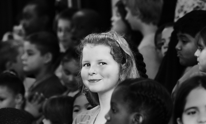 Abigail, almost 9, in her school musical. (Joshua can be spotted North-East of her.)