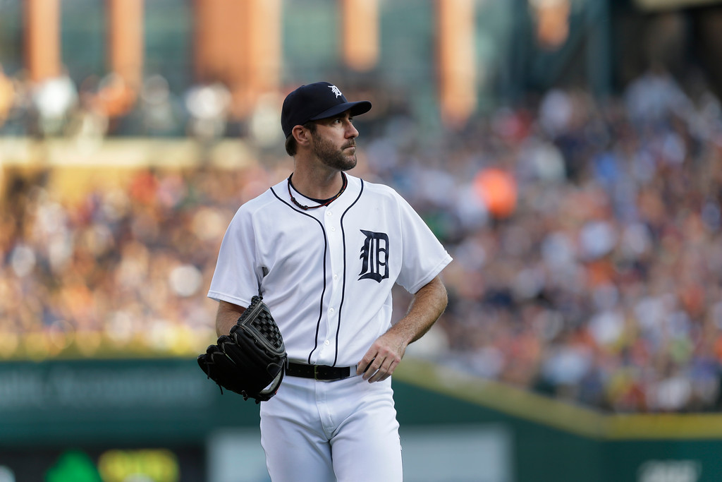 . Detroit Tigers pitcher Justin Verlander walks to the dugout against the Los Angeles Dodgers pitcher in the first inning of a baseball game in Detroit, Tuesday, July 8, 2014. (AP Photo/Paul Sancya)