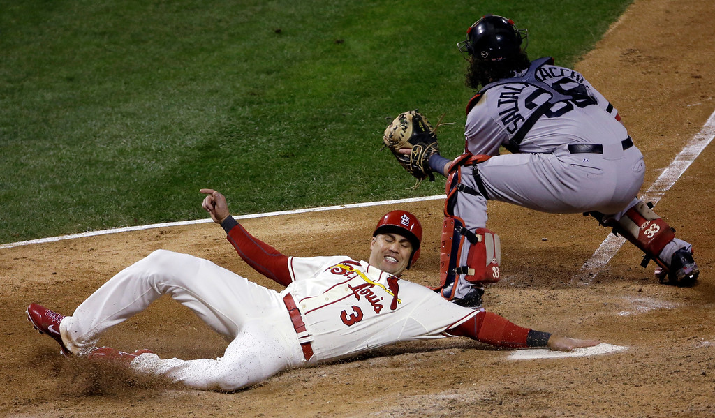 . St. Louis Cardinals\' Carlos Beltran slides safely past Boston Red Sox catcher Jarrod Saltalamacchia during the seventh inning of Game 3 of baseball\'s World Series Saturday, Oct. 26, 2013, in St. Louis. Beltran scored from second on a double by Matt Holliday. (AP Photo/David J. Phillip)