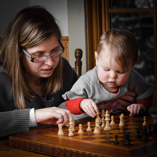 Smart baby plays chess