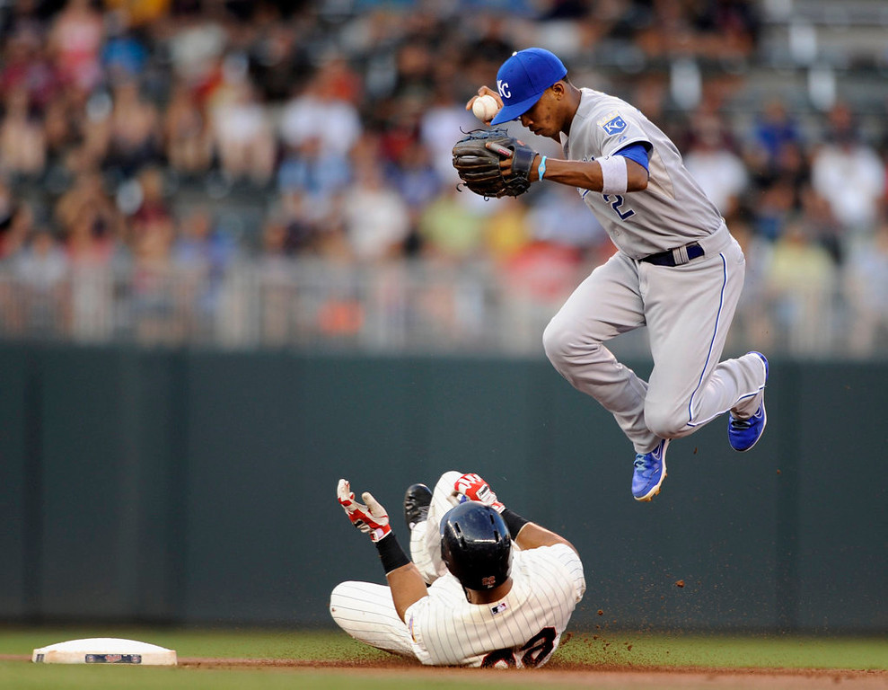 . Wilkin Ramirez #22 of the Minnesota Twins is out at second base as he breaks up the double play attempt by Alcides Escobar #2 of the Kansas City Royals during the first inning of the game. (Photo by Hannah Foslien/Getty Images)