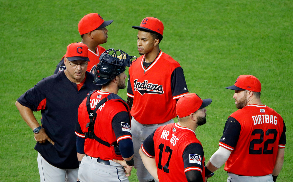 . Cleveland Indians manager Terry Francona, left, waits with his players on the mound during a pitching change in the sixth inning of a baseball game against the Kansas City Royals on Saturday, Aug. 25, 2018, in Kansas City, Mo. (AP Photo/Charlie Riedel)