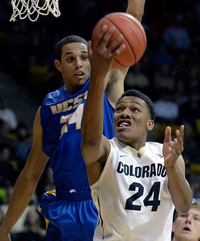 . University of Colorado\'s George King goes for a layup under the arms of Michael Bryson during a game against  the University of California Santa Barbara, on Nov. 20, at the Coors Event Center in Boulder. (Jeremy Papasso/Boulder Daily Camera)