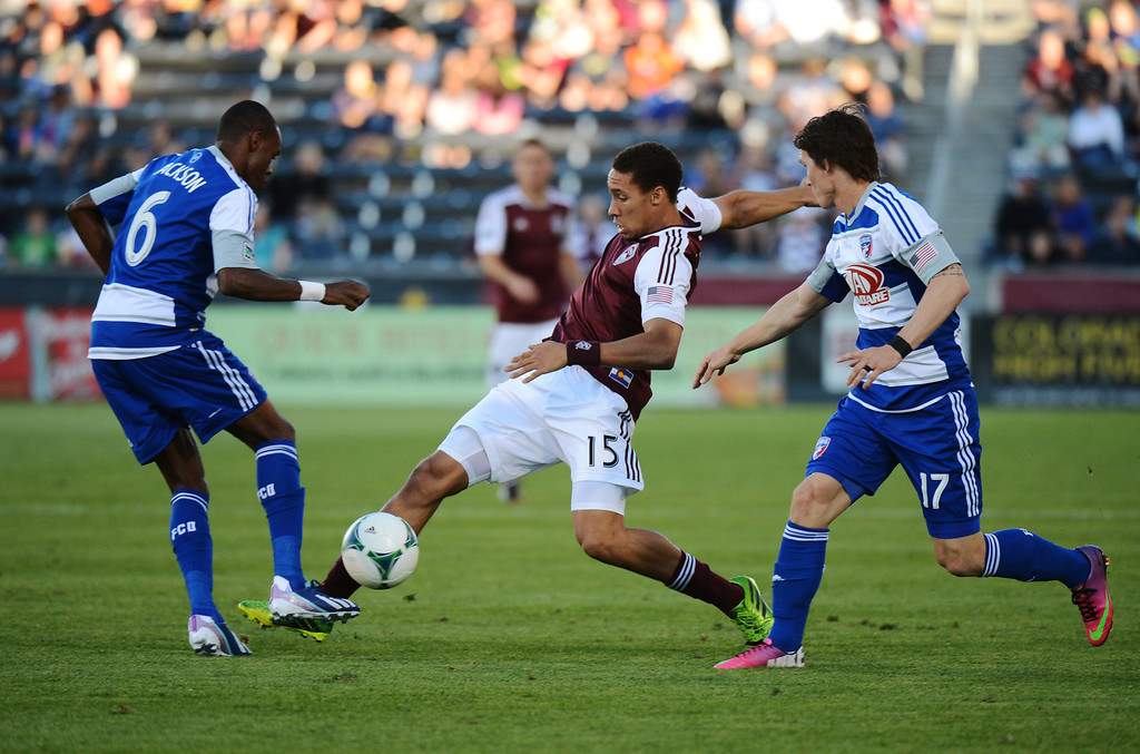 . COMMERCE CITY, CO. - June 01: Christopher Klute of Colorado Rapids (15) trying to control the ball between Jackson of FC Dallas (6) and Zach Loyd (17) in the first half of the game at Dick\'s Sporting Goods Park. Commerce City, Colorado. June 1, 2013. (Photo By Hyoung Chang/The Denver Post)