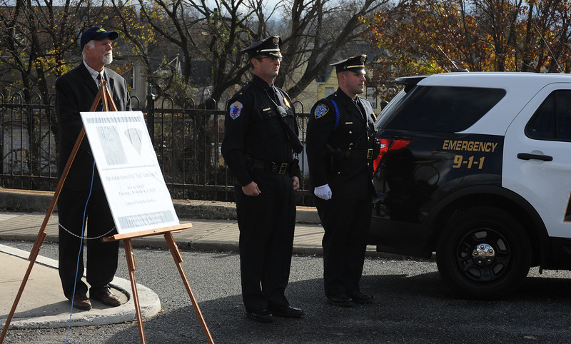 "The Rev. Randy Nelson, left, pastor of Phillipsburg Alliance Church, stands with Phillipsburg Police Chief, Robert Stettner and Sgt. James McDonald. The Phillipsburg Police Department held a remembrance ceremony honoring fallen officer, Kenneth W. ""Red"" Vandegrift who died in the line of duty Nov. 20, 1930. The ceremony was at the bridge on South Main Street that bears his name."
