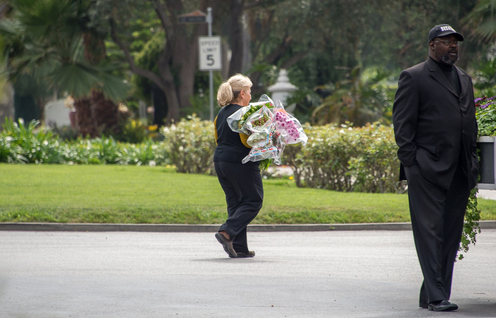 . A woman carries flowers outside  Hollywood Forever Cemetery during the funeral of Mick Jagger\'s  girlfriend LWren Scott  in Hollywood, California on March 25, 2014.  The model-turned-fashion designer was found hanged in her luxury New York apartment last week. She was 49. The cemetery was closed for the roughly one-hour service, held amid tight security.           (JOE KLAMAR/AFP/Getty Images)