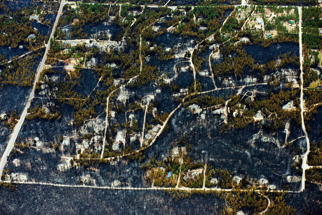 . Burnt trees and destroyed homes are left in the wake of a wildfire in the densely wooded Black Forest area northeast of Colorado Springs, Colo., Thursday, June 13, 2013.  More than 350 homes were lost in what is now the most destructive wildfire in Colorado history, surpassing last year\'s Waldo Canyon fire, which burned 347 homes, killed two people and led to $353 million in insurance claims. (AP Photo/John Wark)
