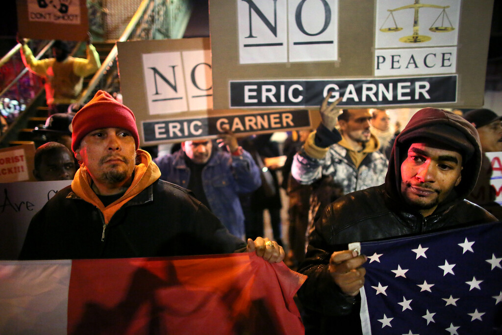 . People gather on E. 125th St. during a protest December 4, 2014 in New York City. Protests began after a Grand Jury decided to not indict officer Daniel Pantaleo. Eric Garner died after being put in a chokehold by Pantaleo on July 17, 2014. Pantaleo had suspected Garner of selling untaxed cigarettes. (Photo by Yana Paskova)