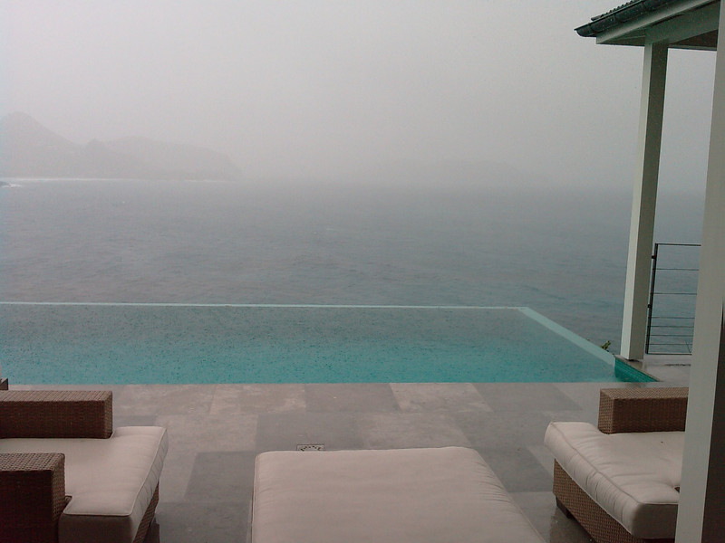 """St Barth 2008 - 13th day  This morning, it was raining cats and dogs! So, it was time to do some shopping again in Gustavia (Blanc Bleu, Carat, Vuitton, Pati de St Barth).  After lunch, the weather was again """"normal"""" and we could intensively benefit from the swimming-pool at the villa. Good simple dinner at Andy.  I have just finished to read a bit more than 800 new pages, on top of the """"first"""" 1'500. No book anymore now..."""