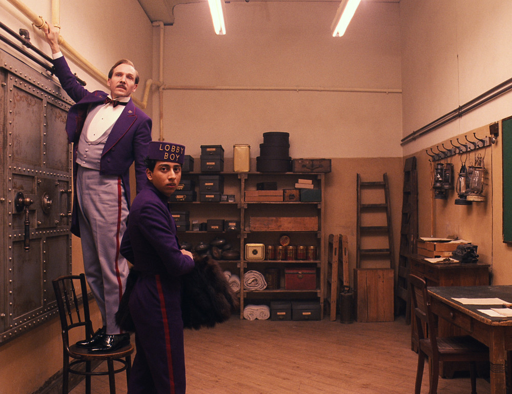 """. This image released by Fox Searchlight shows Ralph Fiennes, left, and Tony Revolori in \""""The Grand Budapest Hotel. \""""  The film was nominated for a Golden Globe for best comedy on Thursday, Dec. 11, 2014. The 72nd annual Golden Globe awards will air on NBC on Sunday, Jan. 11. (AP Photo/Fox Searchlight)"""