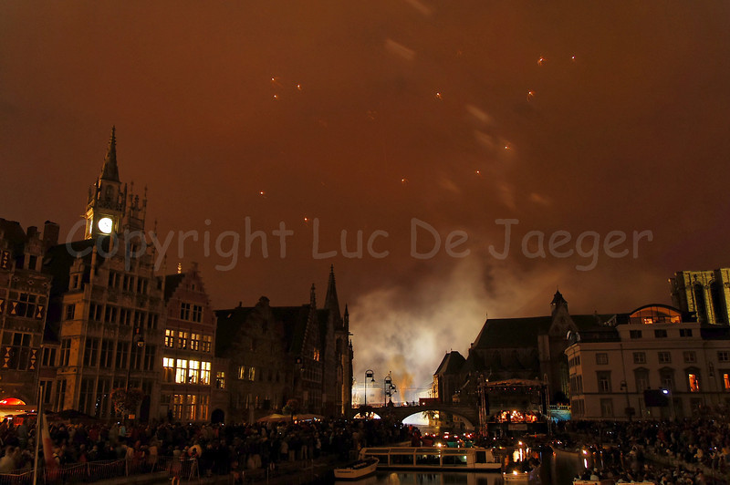 Fireworks, shot from the St Michielsbrug (St Michael's bridge) in Ghent (Gent), Belgium, end the OdeGand festivities. Even the fireworks end, leaving smoke around the bridge.