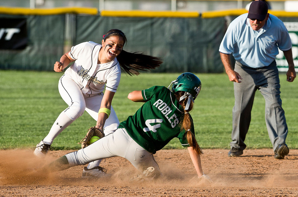 . Northview\'s Sarina Jaramillo (#20) tags out South Hills\' Lexi Robles (#4) in the sixth inning during San Gabriel Valley all-star softball game at Diamond Bar High School on Monday, June 3, 2013. South team won 10-5. (Staff photo by Watchara Phomicinda/ Los Angeles Media News Group)