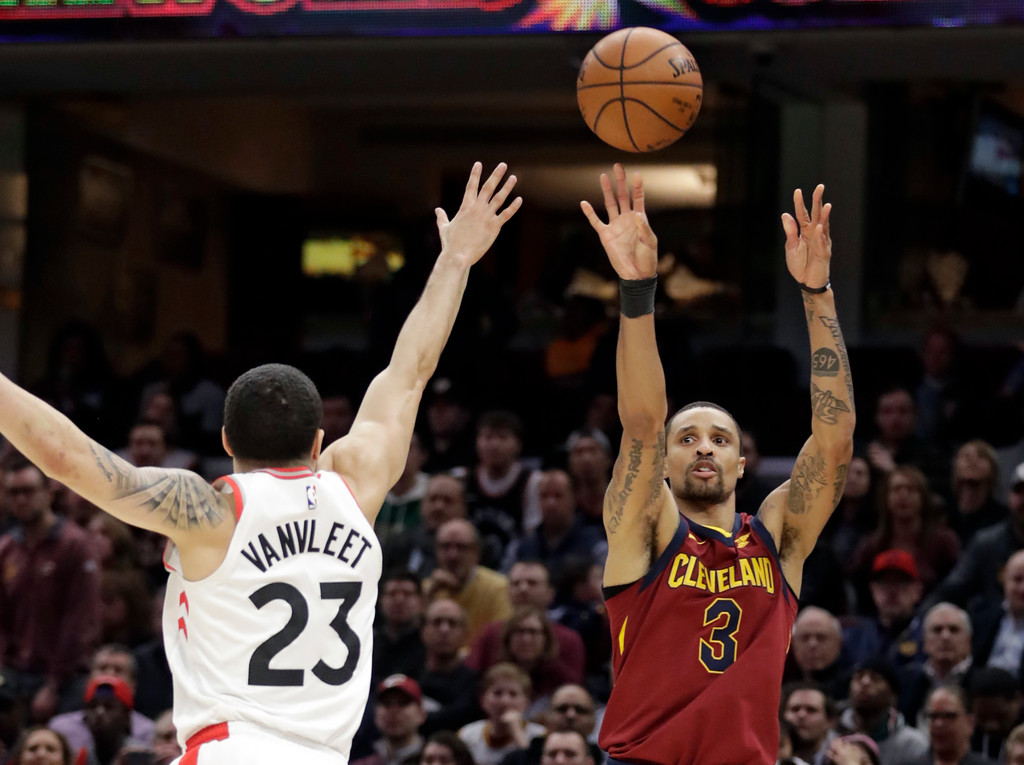 . Cleveland Cavaliers\' George Hill (3) shoots over Toronto Raptors\' Fred VanVleet (23) during the second half of an NBA basketball game Wednesday, March 21, 2018, in Cleveland. The Cavaliers won 132-129. (AP Photo/Tony Dejak)