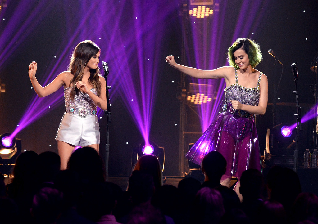 . Singers Kacey Musgraves (L) and Katy Perry perform onstage during CMT Crossroads: Katy Perry And Kacey Musgraves at Sony Pictures Studios on April 18, 2014 in Culver City, California.  (Photo by Rick Diamond/Getty Images for CMT)