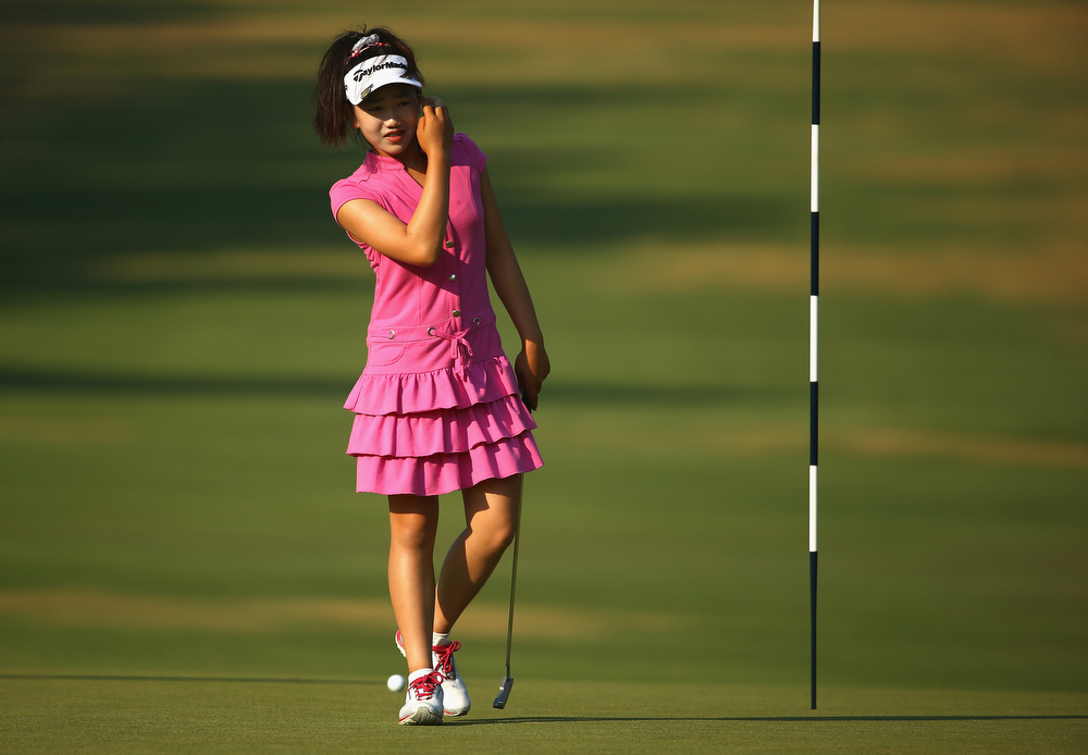 . Eleven-year old Amateur Lucy Li of the United States walks the first green during a practice round prior to the start of the 69th U.S. Women\'s Open at Pinehurst Resort & Country Club, Course No. 2 on June 18, 2014 in Pinehurst, North Carolina.  (Photo by Streeter Lecka/Getty Images)