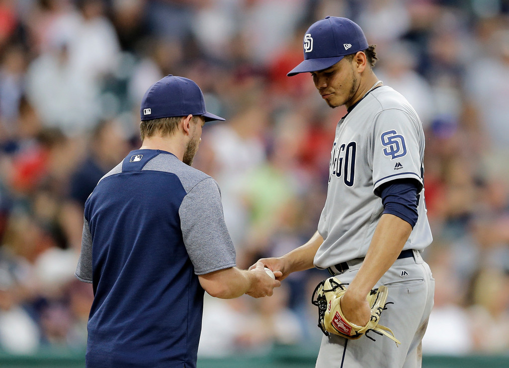 . San Diego Padres starting pitcher Dinelson Lamet, right, hands the ball to manager Andy Green after giving up a solo home run to Edwin Encarnacion in the fifth inning of a baseball game, Thursday, July 6, 2017, in Cleveland. (AP Photo/Tony Dejak)