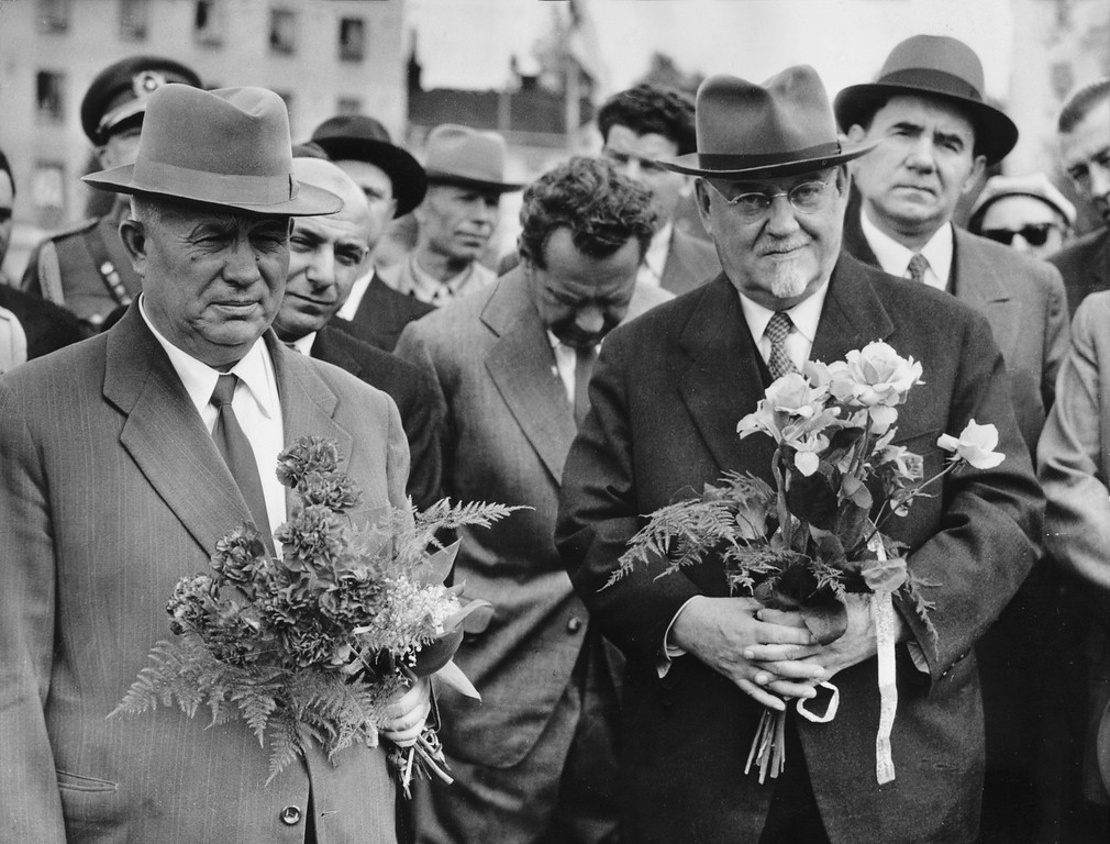 . 1957: Nikita Khrushchev. Holding a bunch of flowers Nikita Khrushchev, first secretary of the Communist Party of the Soviet Union (CPSU) and Soviet Prime Minister Marshal Nikolai Bulganin, right, pose for photographers at their arrival in Lahti, Finland, June 13, 1957. (AP Photo/Str)