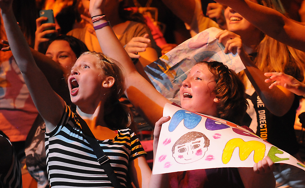 . Leora Feinsten, right, and her friend Miriam Jepsem, both 14 years-old and both from St. Paul, reach out for Niall Horan with the band One Direction as he they  perform at  the Target Center, in Minneapolis, Thursday, July 18, 2013.  (Pioneer Press: John Autey)