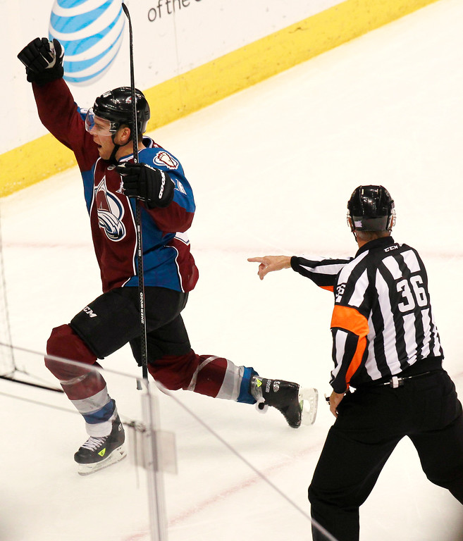 . Colorado Avalanche center Paul Stastny, left, celebrates scoring the go-ahead goal as referee Dean Morton looks on against the Winnipeg Jets in the third period of the Avalanche\'s 3-2 victory in an NHL hockey game in Denver on Sunday, Oct. 27, 2013. (AP Photo/David Zalubowski)